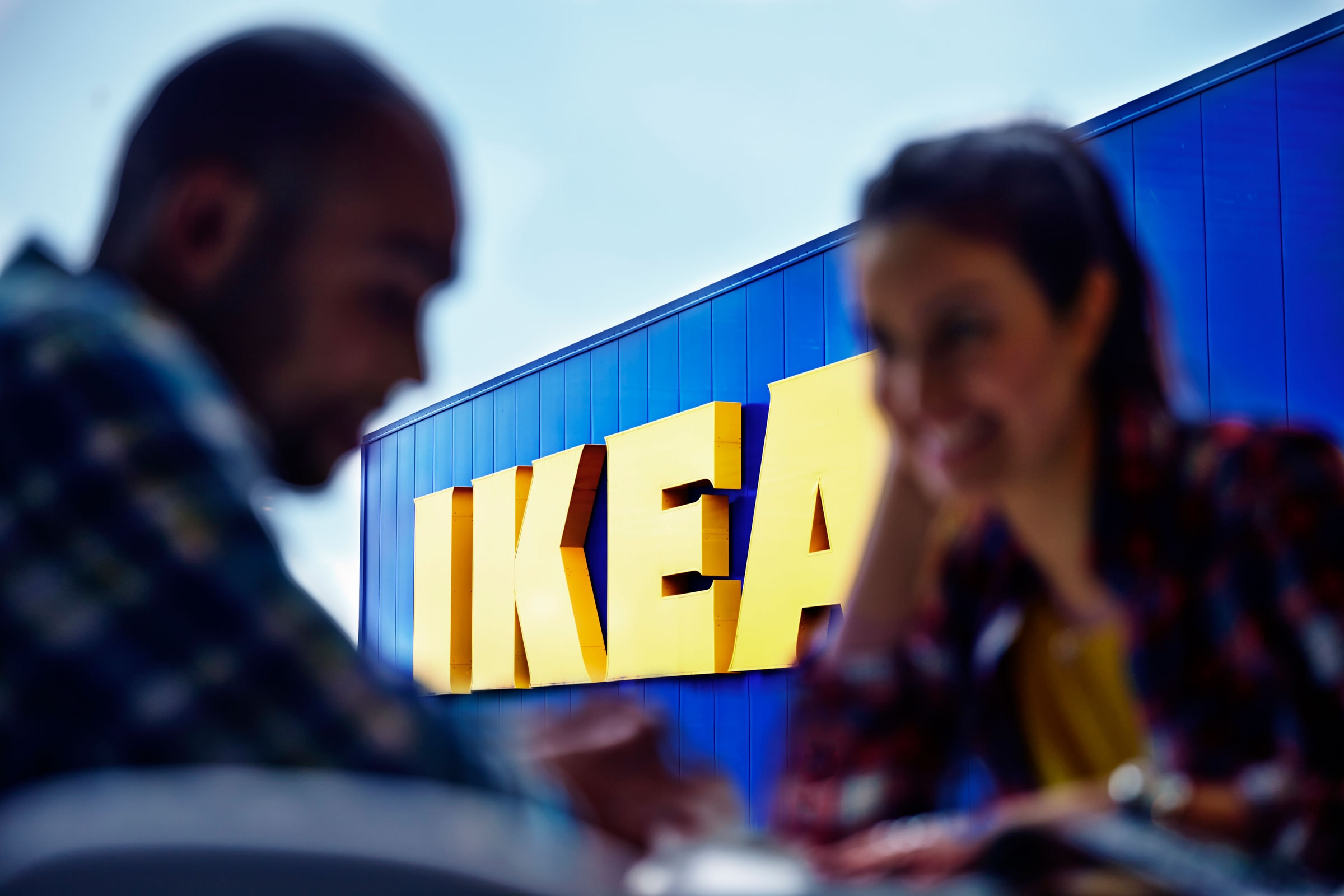blurry-close-up-man-and-woman-in-front-of-ikea-store