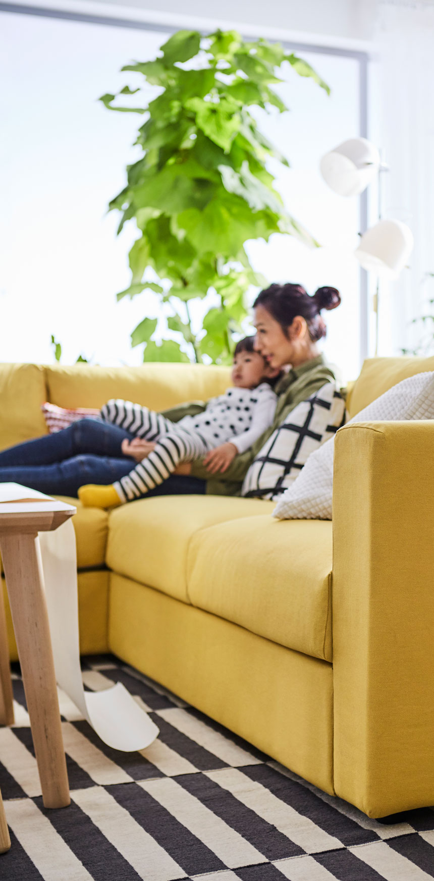mother-and-kid-sitting-in-a-yellow-sofa