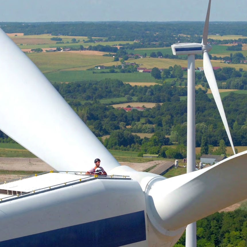 technicians-on-top-of-wind-turbines-overviewing-landscape