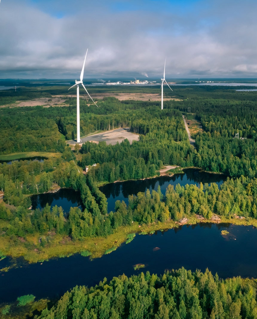 wind-turbines-in-wooden-landscape-with-small-lakes-in-the-foreground
