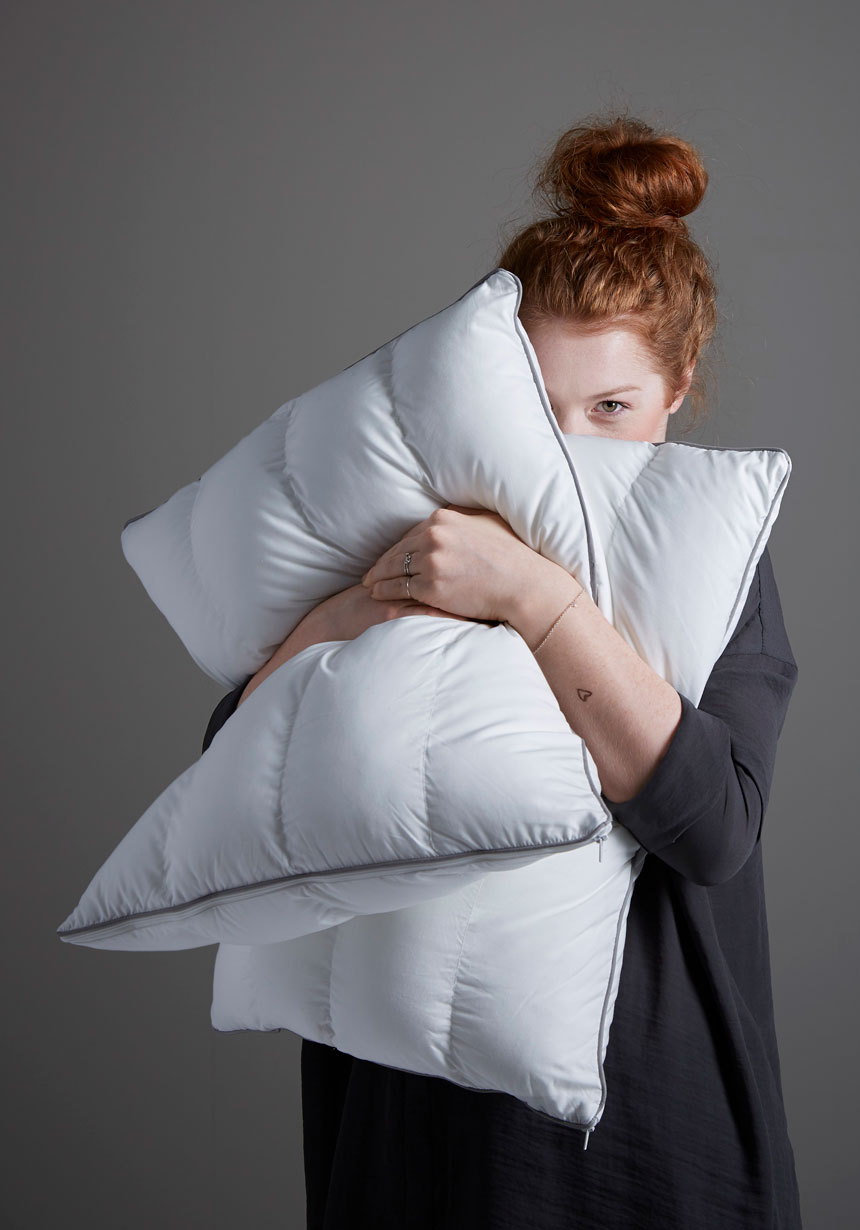 woman-holding-two-pillows